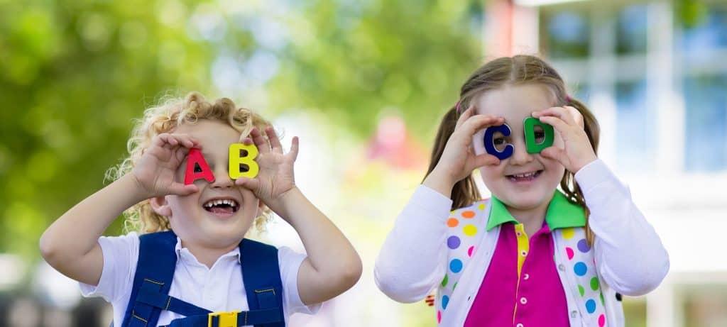 Two happy children on their first day of Kindergarten