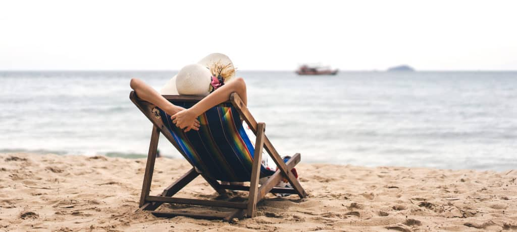 Woman relaxes on beach chair after finding balance