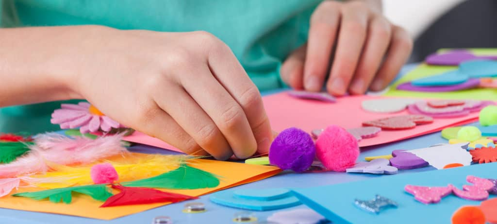 Child doing craft activities