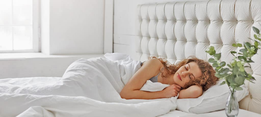 Woman has morning sleep in bed after a good night's sleep