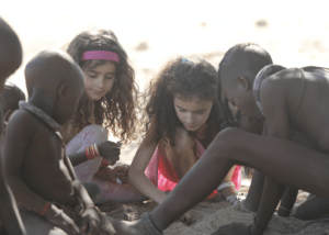 Antonella's children playing with the Himba children Photo Credit: Dave Southwood davesouthwood.photography