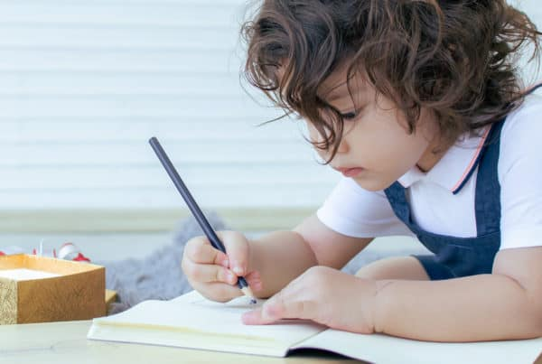 Child draws on paper