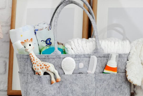 handbag with baby essentials in it