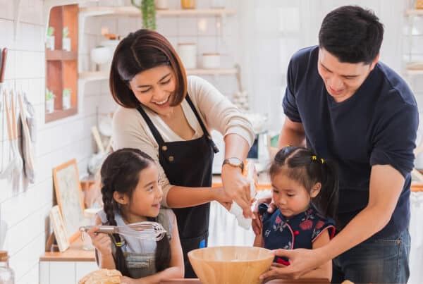 Family enjoys time together cooking dinner thanks to optus pause